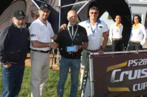 Enrico Gemme (second from right) receiving the Bigatmo sunglasses from Matthew Harvey