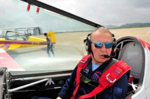 Mark wearing Iono 0501, sitting in the cockpit