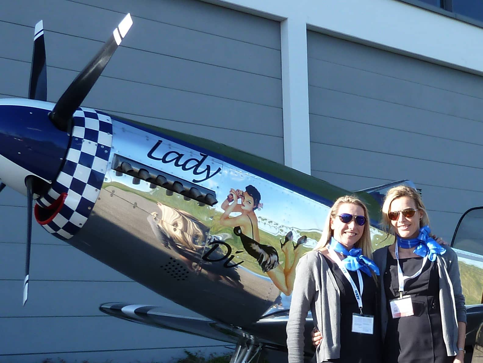 Girls-Freidrichshafen-beside-plane-nose-art