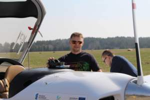 Lesny wearing Strato 0150 standing by the cockpit